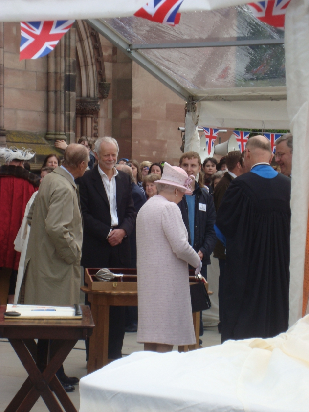 The Queen looks at Hereford Cathedral's Mace