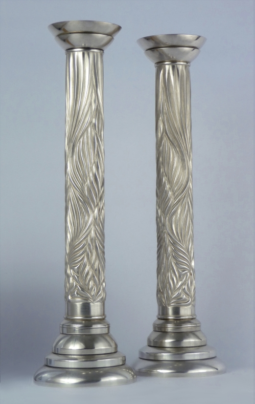 'Chased' silver candlesticks